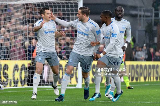 Leighton Baines of Everton celebrates scoring his penalty with Gylfi Sigurdsson and Ademola Lookman during the Premier League match between Crystal...