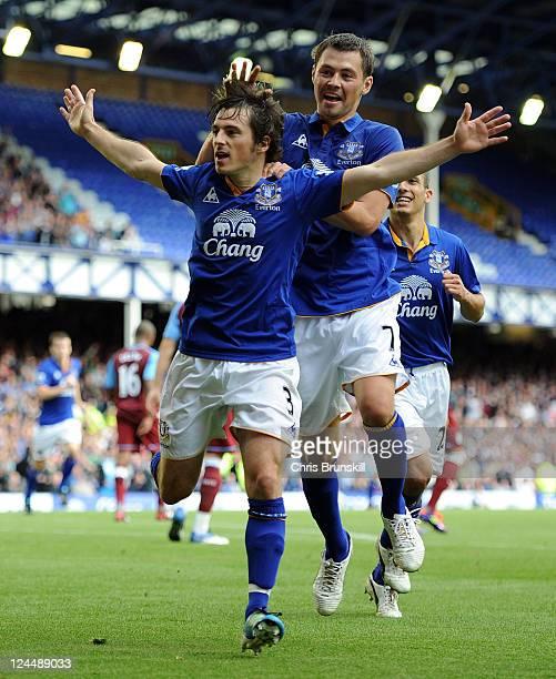 Leighton Baines of Everton celebrates scoring his team's second goal with teammate Diniyar Bilyaletdinov during the Barclays Premier League match...