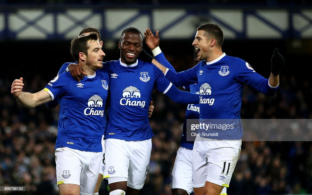 Leighton Baines of Everton celebrates scoring his team's second goal with Enner Valencia (C) and Kevin Mirallas (R) during the Premier League match between Everton and Southampton at Goodison Park on January 2, 2017 in Liverpool, England.