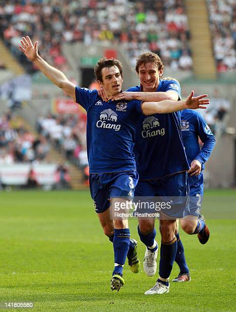 Leighton Baines of Everton celebrates scoring the first goal from a freekick during the Barclays Premier League match between Swansea City and...