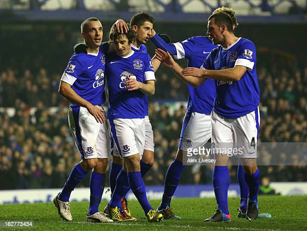 Leighton Baines of Everton celebrates with Leon Osman and team mates after scoring the second goal from the penalty spot during the FA Cup fifth...