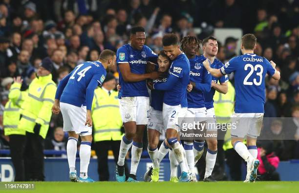 Leighton Baines of Everton celebrates with teammates after scoring his team's second goal during the Carabao Cup Quarter Final match between Everton...