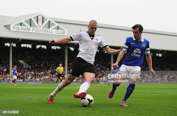 Leighton Baines of Everton closes down Pajtim Kasami of Fulham during the Barclays Premier League match between Fulham and Everton at Craven Cottage...
