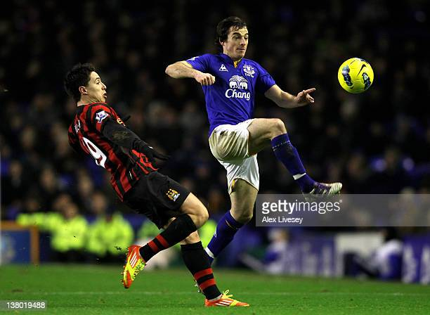 Leighton Baines of Everton competes with Samir Nasri of Manchester City during the Barclays Premier League match between Everton and Manchester City...