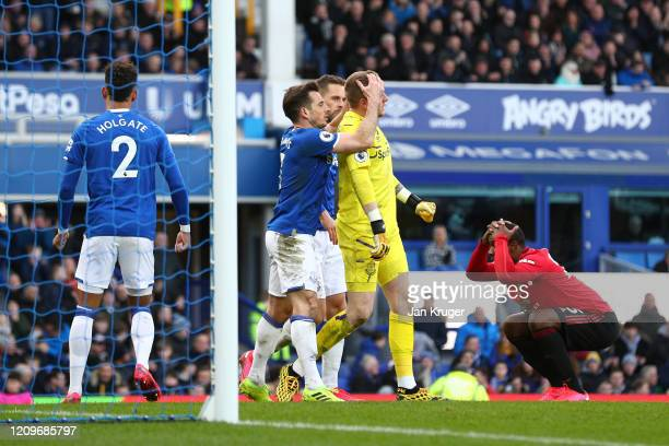 Leighton Baines of Everton congratulates Jordan Pickford of Everton after making an important save during the Premier League match between Everton FC...