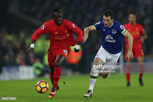 Leighton Baines of Everton in action with Sadio Mane of Liverpool during the Premier League match between Everton and Liverpool at Goodison Park on...