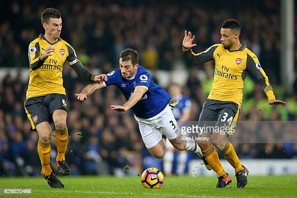 Leighton Baines of Everton is brought down by Francis Coquelin of Arsenal during the Premier League match between Everton and Arsenal at Goodison...
