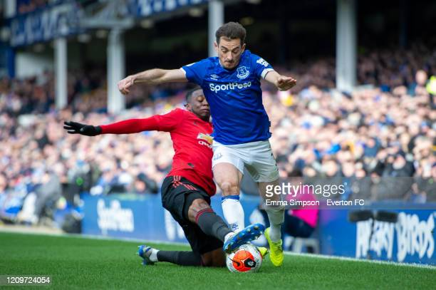 Leighton Baines of Everton is challenged by Aaron WanBissaka of Manchester United during the Premier League match between Everton FC and Manchester...