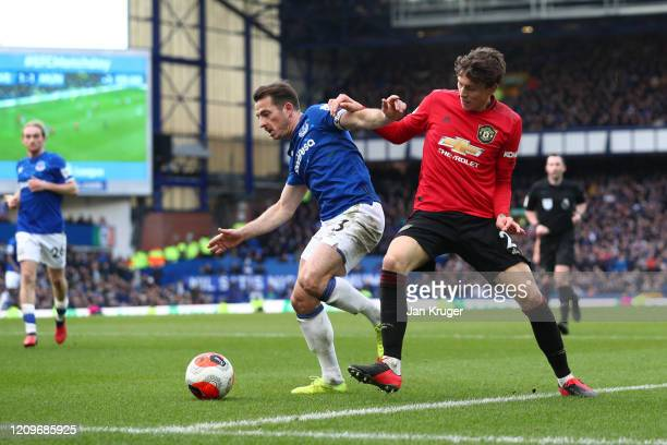 Leighton Baines of Everton is challenged by Victor Lindelof of Manchester United during the Premier League match between Everton FC and Manchester...