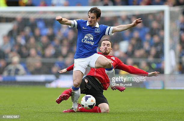 Leighton Baines of Everton is tackled by Jordan Mutch of Cardiff City during the Barclays Premier League match between Everton and Cardiff City at...
