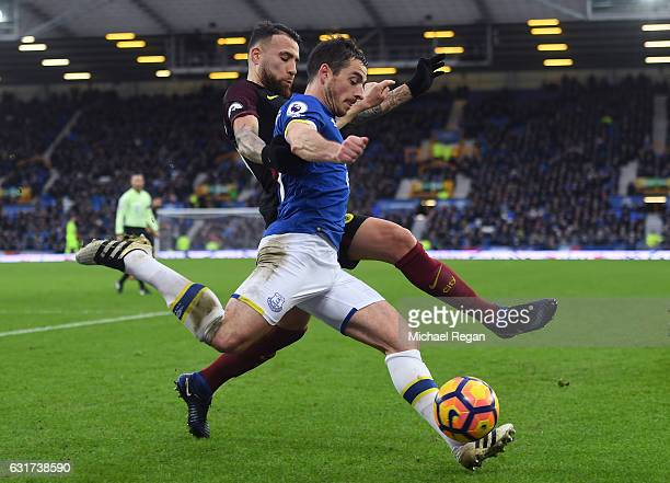 Leighton Baines of Everton is tackled by Nicolas Otamendi of Manchester City during the Premier League match between Everton and Manchester City at...