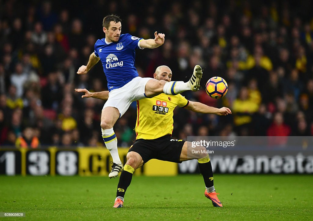 Leighton Baines of Everton jumps to challenge Nordin Amrabat of Watford during the Premier League match between Watford and Everton at Vicarage Road on December 10, 2016 in Watford, England.