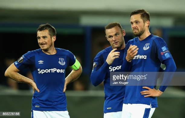 Leighton Baines of Everton looks on as Wayne Rooney and Gylfi Sigurdsson discuss a freekick during the UEFA Europa League group E match between...