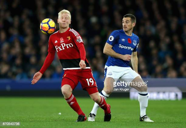 Leighton Baines of Everton puts pressure on Will Hughes of Watford during the Premier League match between Everton and Watford at Goodison Park on...