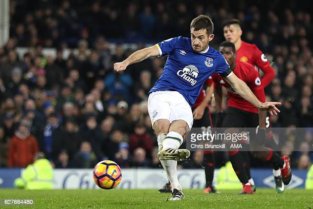 Leighton Baines of Everton scores an equalising goal from a penalty to make the score 11 during the Premier League match between Everton and...