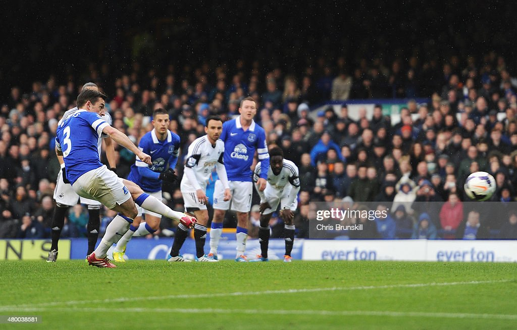 Leighton Baines of Everton scores from the penalty spot during the Barclays Premier League match between Everton and Swansea City at Goodison Park on March 22, 2014 in Liverpool, England.