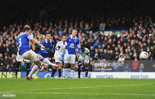 Leighton Baines of Everton scores from the penalty spot during the Barclays Premier League match between Everton and Swansea City at Goodison Park on...