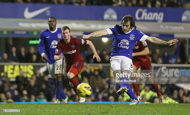 Leighton Baines of Everton scores his second goal from the penalty spot during the Barclays Premier League match between Everton and West Bromwich...