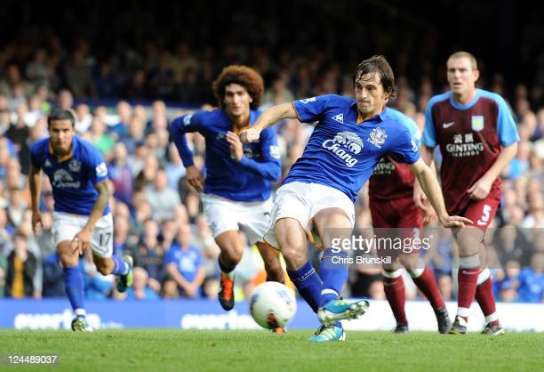 Leighton Baines of Everton scores his team's second goal from the penalty spot during the Barclays Premier League match between Everton and Aston...