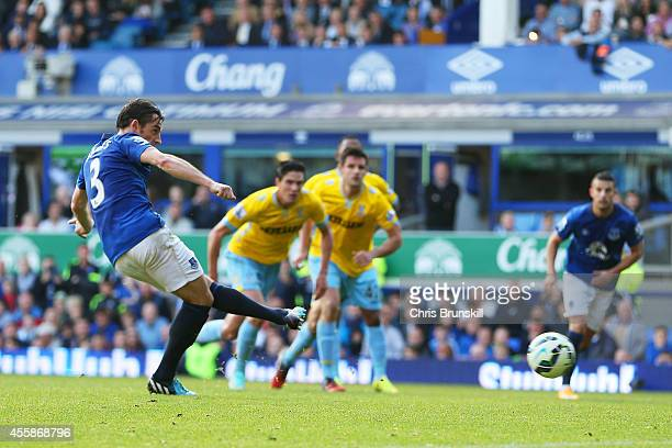 Leighton Baines of Everton scores his team's second goal from the penalty spot during the Barclays Premier League match between Everton and Crystal...