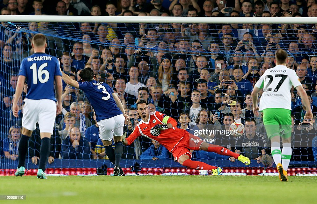 Leighton Baines of Everton scores his team's third goal from the penalty spot past goalkeeper Diego Benaglio of VfL Wolfsburg during the UEFA Europa League Group H match between Everton and VFL Wolfsburg on September 18, 2014 in Liverpool, United Kingdom.