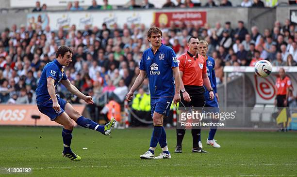 Leighton Baines of Everton scores the first goal from a freekick during the Barclays Premier League match between Swansea City and Everton at the...