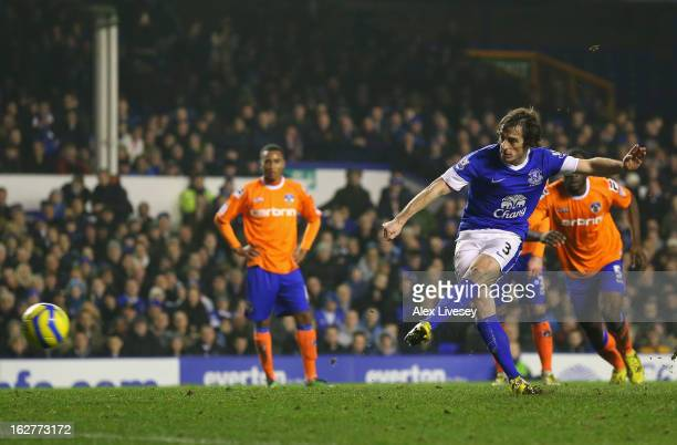 Leighton Baines of Everton scores the second goal from the penalty spot during the FA Cup fifth round replay match between Everton and Oldham...