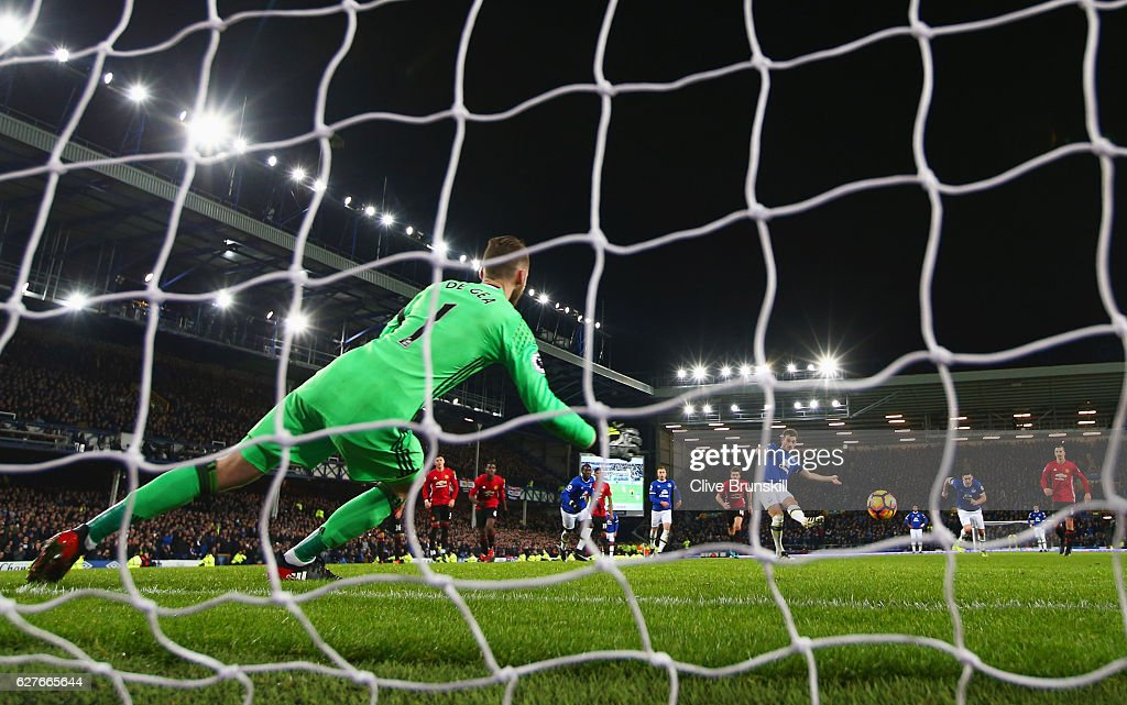 Leighton Baines of Everton scores their first and equalising goal from the penalty spot past goalkeeper David De Gea of Manchester United during the Premier League match between Everton and Manchester United at Goodison Park on December 4, 2016 in Liverpool, England.