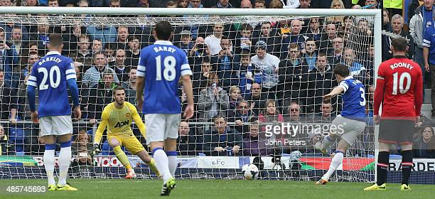 Leighton Baines of Everton scores their first goal during the Barclays Premier League match between Everton and Manchester United at Goodison Park on...