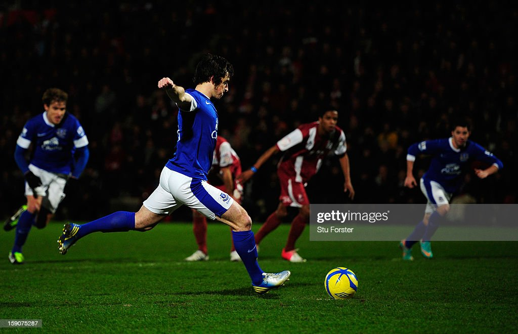 Leighton Baines of Everton scores their second goal from the penalty spot during the FA Cup with Budweiser Third Round match between Cheltenham Town and Everton at Abbey Business Stadium on January 7, 2013 in Cheltenham, England.