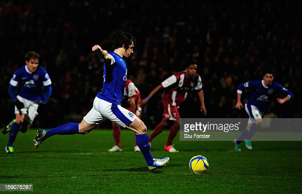 Leighton Baines of Everton scores their second goal from the penalty spot during the FA Cup with Budweiser Third Round match between Cheltenham Town...