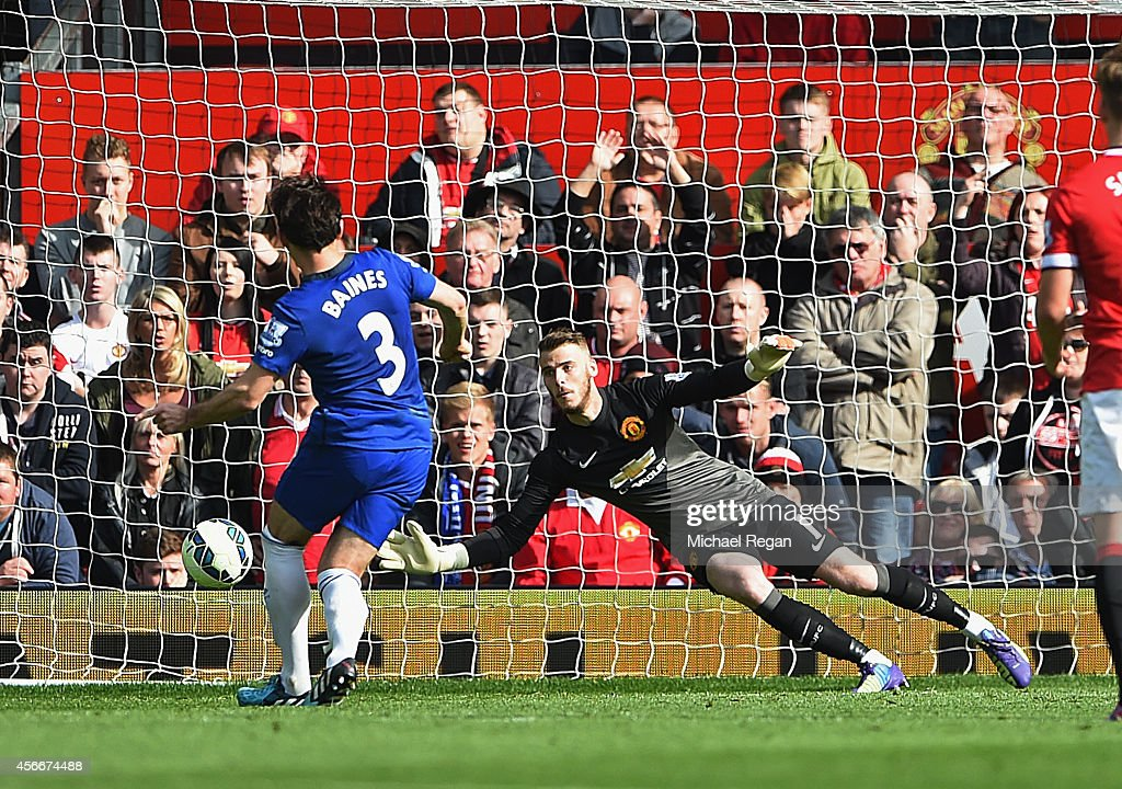 Leighton Baines of Everton takes and has a penalty kick saved by David De Gea of Manchester United during the Barclays Premier League match between Manchester United and Everton at Old Trafford on October 5, 2014 in Manchester, England.