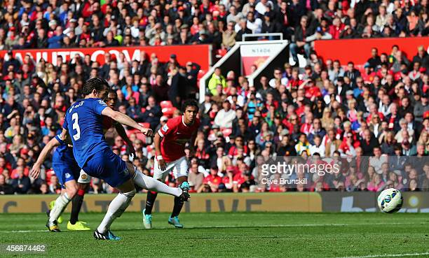 Leighton Baines of Everton takes and misses a penalty kick during the Barclays Premier League match between Manchester United and Everton at Old...