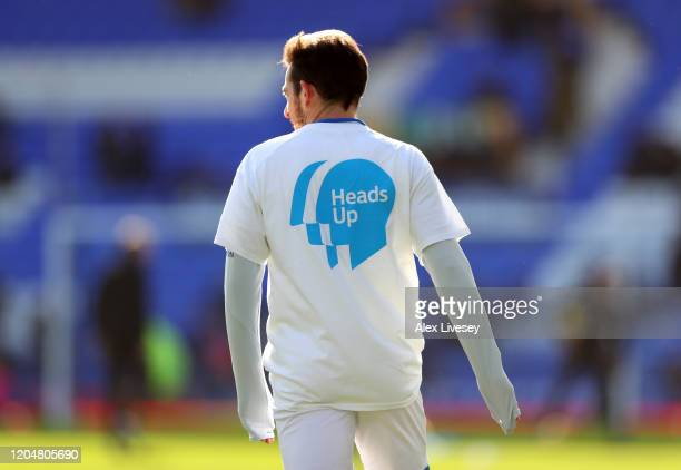 Leighton Baines of Everton warms up while wearing a Heads Up Campaign tshirt during the Premier League match between Everton FC and Crystal Palace at...