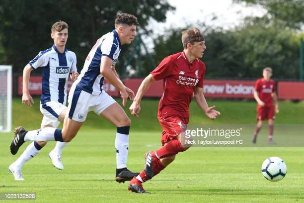 Leighton Clarkson of Liverpool and Zak Delaney of West Bromwich Albion in action during the Liverpool U18 v West Bromwich Albion U18 game at The...