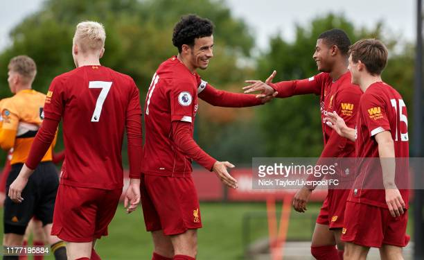 Leighton Clarkson of Liverpool celebrates with team mates Luis Longstaff Curtis Jones and Rhian Brewster after his shot is deflected into the net...