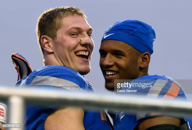Leighton Vander Esch and Cedrick Wilson of the Boise State Broncos smile after the Broncos defeated the Oregon Ducks in the Las Vegas Bowl at Sam...