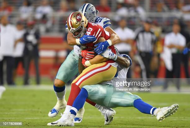 Leighton Vander Esch and Justin MarchLillard of the Dallas Cowboys tackles Marcell Harris of the San Francisco 49ers in the second quarter of their...