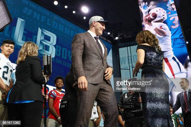 Leighton Vander Esch of Boise State reacts after being picked overall by the Dallas Cowboys during the first round of the 2018 NFL Draft at ATT...