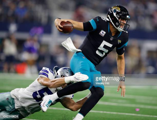 Leighton Vander Esch of the Dallas Cowboys tries to take down Blake Bortles of the Jacksonville Jaguars in the fourth quarter of a game at ATT...