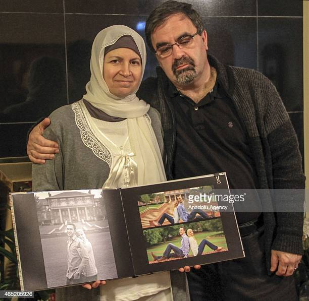 Leila Barakat mother of shooting victim Deah Shaddy Barakat and her husband Namee Barakat show the photo album of their son after they speak to the...