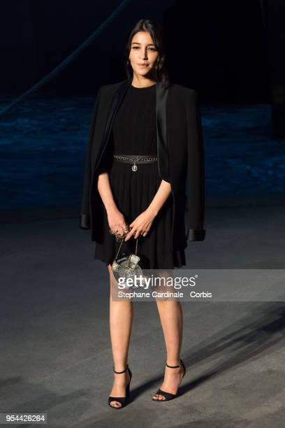Leila Bekthi attends the Chanel Cruise 2018/2019 Collection at Le Grand Palais on May 3 2018 in Paris France
