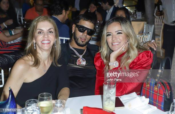 Leila Cobo, Anuel AA and Karol G attend the T.J. Martell 2019 Miami Dinner at Estefan Kitchen on February 20, 2019 in Miami, Florida.