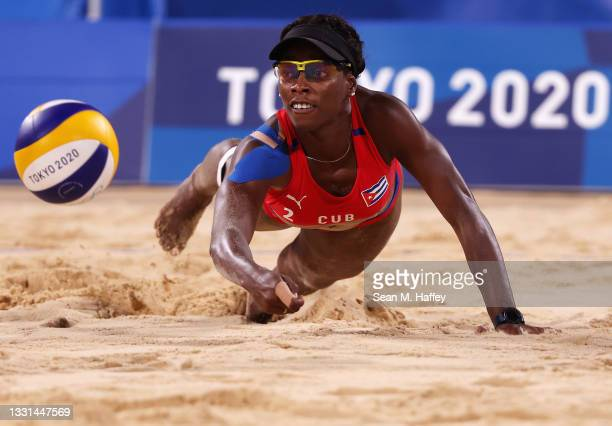 Leila Consuelo Martinez Ortega of Team Cuba competes against Team Italy during the Women's Preliminary - Pool E beach volleyball on day seven of the...