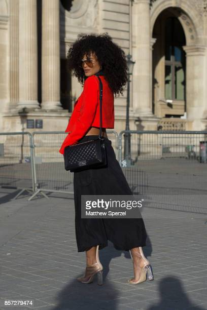 Leila Depina is seen attending Louis Vuitton during Paris Fashion Week wearing BCBG Forever 21 and vintage on October 3 2017 in Paris France