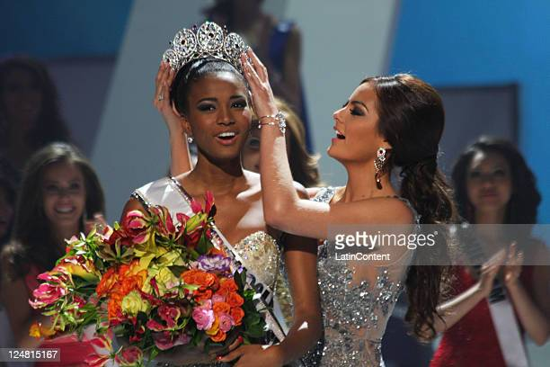 Leila Lopes from Angola receives the crown of Miss Universe 2011 from the former Queen Ximena Navarrete at Credicard Hall on September 12 2011 in Sao...