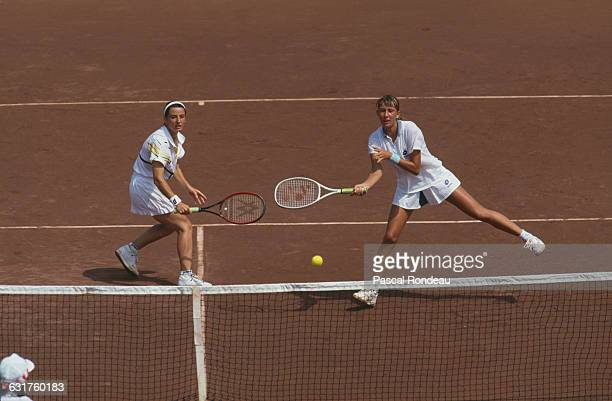Leila Meskhi and Natasha Zvereva of the Unified Team competing against Gigi Fernández and Mary Joe Fernández of the USA in the semifinals of the...