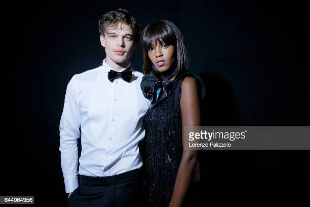 Leila Nda and model are seen backstage ahead of the Emporio Armani show during Milan Fashion Week Fall/Winter 2017/18 on February 24, 2017 in Milan,...