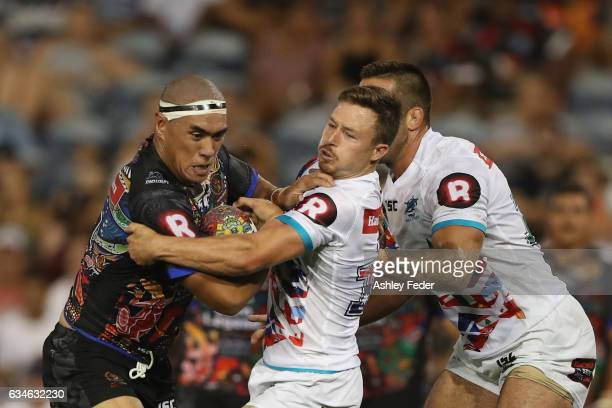 Leilani Latu of Indigenous All Stars is tackled by Gavin Cooper of the World All Stars during the NRL All Stars match between the 2017 Harvey Norman...