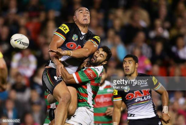 Leilani Latu of the Panthers runs into Alex Johnston of the Rabbitohs contesting a high ball during the round six NRL match between the Penrith...
